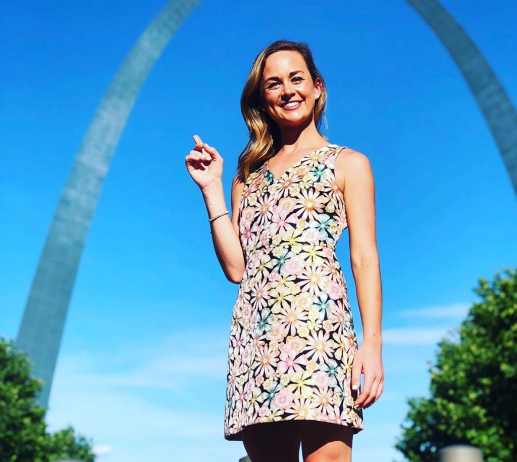 Emma Hogg, who currently reports for the KMOV in St. Louis, posing with the city's famous archs
