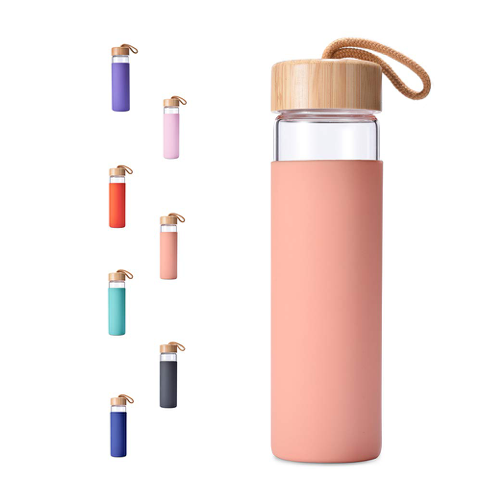 A pink Yomious Glass Water Bottle, a perfect gift for your loved ones for the holidays!